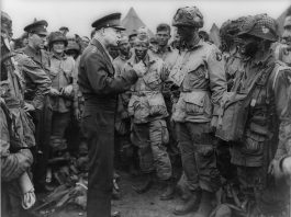 Dwight D. Eisenhower speaks with American paratroopers of the 502nd Parachute Infantry Regiment, 101st Airborne Division on the evening of June 5, 1944.